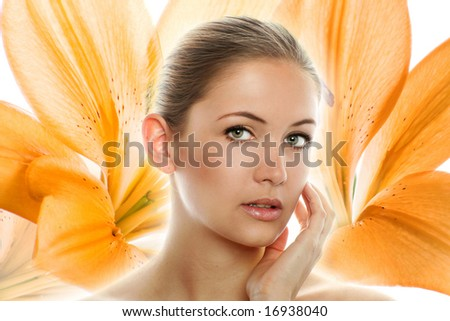 beauty portrait of a young woman background with a flower in background - stock photo