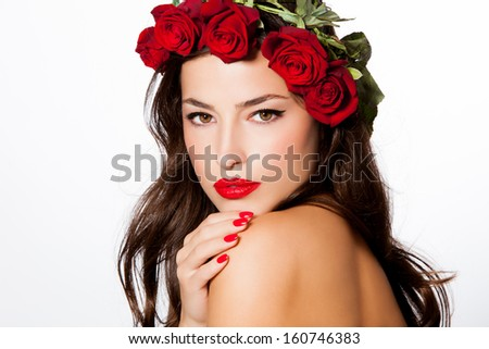 beauty portrait of a young woman with a wreath of red roses on her head, studio white - stock photo