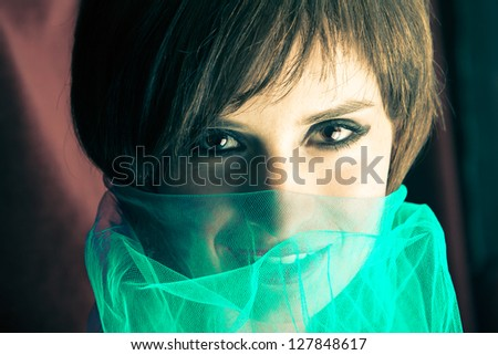 Beauty portrait of a young woman with veil - stock photo