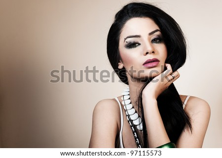 beauty portrait of an attractive Indian girl wearing jewelry - stock photo