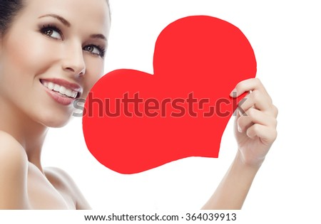 beauty portrait of attractive  caucasian smiling young woman isolated on white studio shot face skin red heart valentine's love - stock photo