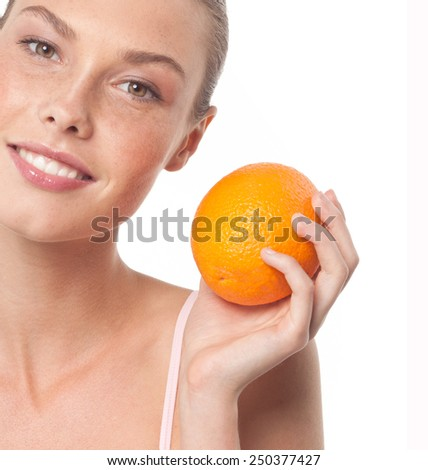 beauty portrait of attractive young caucasian smiling woman isolated on white studio shot with orange fruit - stock photo