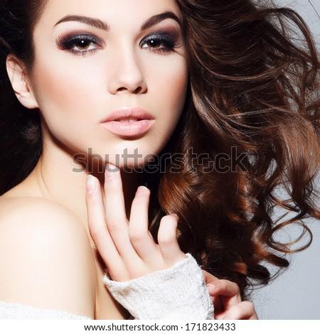 Beauty portrait of beautiful brunette girl in the studio - stock photo