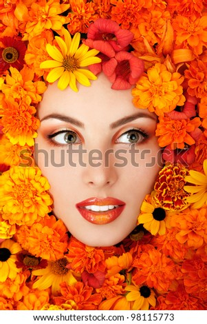 beauty portrait of beautiful female face with orange flowers frame - stock photo