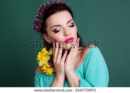 Beauty portrait of beautiful girl with purple wreath of flowers in hair - stock photo