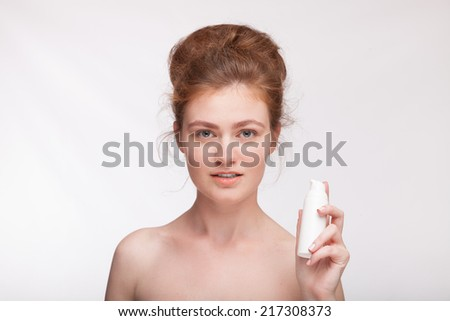 Beauty portrait of beautiful woman showing beauty product. Caucasian female model  - stock photo