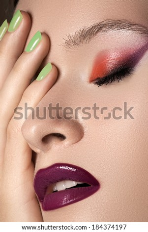 Beauty portrait of beautiful woman with summer colors make-up and manicure. Perfect clean and smooth skin, green mint nail polish, bright eyes and lips makeup  - stock photo