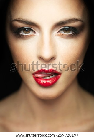 beauty portrait of beautiful young brunette girl wearing make-up, with mouth open, showing tongue. closeup image - stock photo