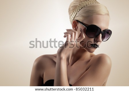 beauty portrait of blond girl with hair style black lips looking down isolated over white - stock photo