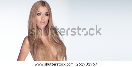 Beauty portrait of blonde attractive woman with long healthy hair. Girl posing naked. Studio shot. - stock photo