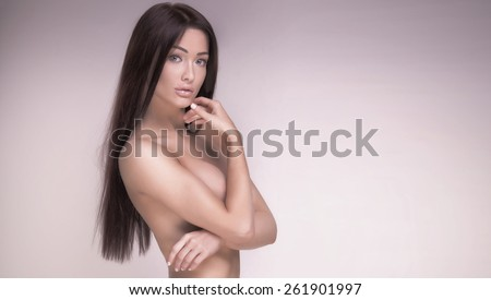 Beauty portrait of brunette attractive woman with long healthy hair. Girl posing naked. Studio shot. - stock photo