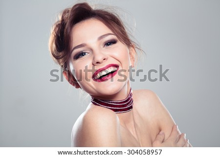 Beauty portrait of cute beautiful girl expressed makeup - stock photo