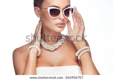 Beauty portrait of elegant attractive blonde woman wearing pearls and stylish sunglasses.  - stock photo