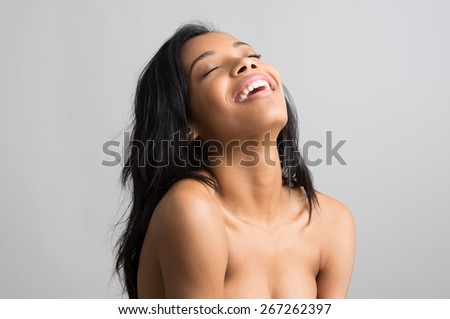 Beauty portrait of happy young african woman with eye closed isolated on grey background  - stock photo
