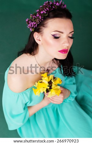 Beauty portrait of pretty girl with purple wreath of flowers in hair - stock photo