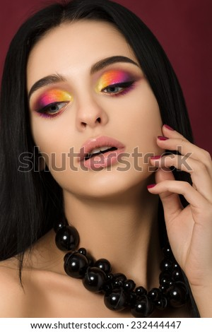 Beauty portrait of woman with colourful eye makeup - stock photo