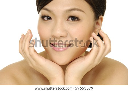Beauty portrait of young asian woman with healthy skin on a face - stock photo