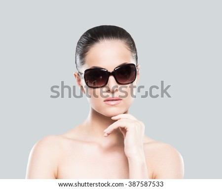 Beauty portrait of young, attractive, fresh, healthy and natural woman in sunglasses - stock photo