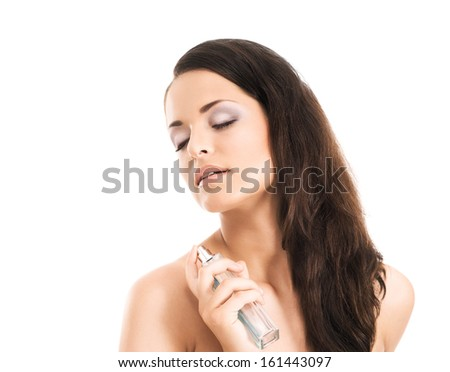 Beauty portrait of young, attractive, fresh, healthy and natural woman with the perfume bottle isolated on white - stock photo