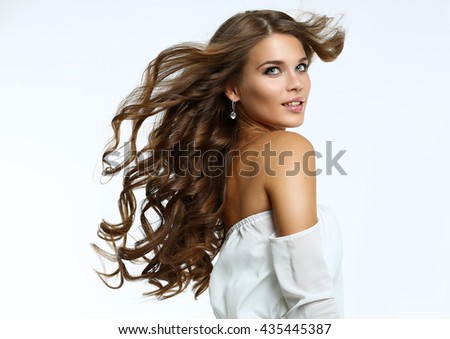 Beauty portrait of young attractive haired woman - stock photo