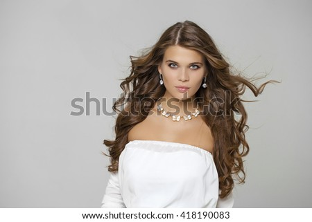 Beauty portrait of young attractive haired woman, isolated on gray background  - stock photo