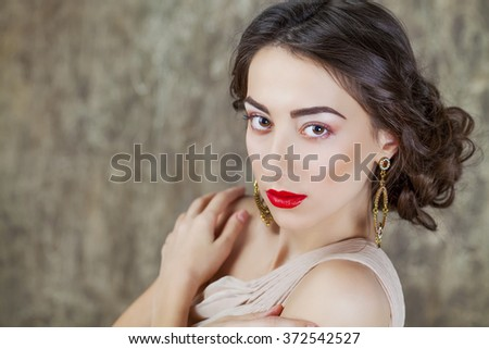 Beauty portrait of young attractive woman on dark studio wall - stock photo