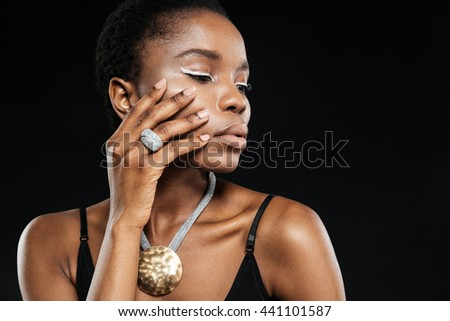 Beauty portrait of young beautiful ethnic african girl isolated on the black background - stock photo