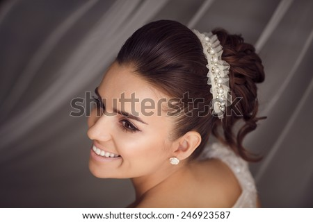 Beauty portrait of young bride. Perfect makeup and hairstyle. - stock photo