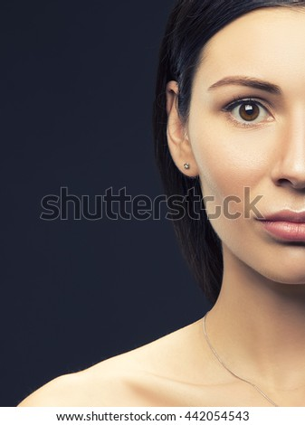Beauty portrait of young brunette caucasian attractive sad woman with natural make-up. Studio portrait. Toned - stock photo