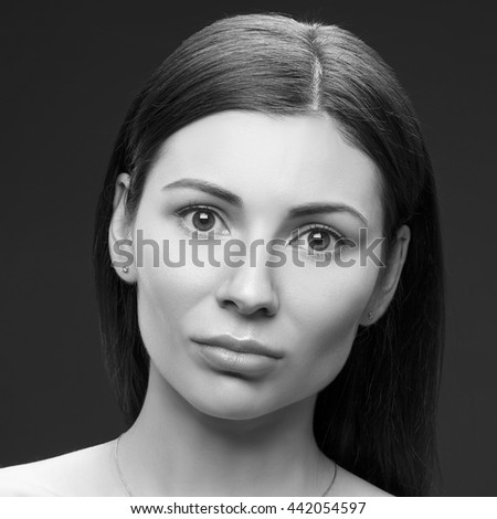 Beauty portrait of young brunette caucasian attractive sad woman with natural make-up. Studio portrait. Black and white - stock photo