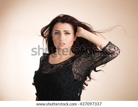 Beauty portrait of young healthy woman with hair blowing - stock photo