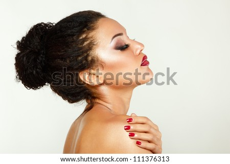 Beauty portrait of young mulatto fresh woman with beautiful makeup in profile. Isolated on white background - stock photo