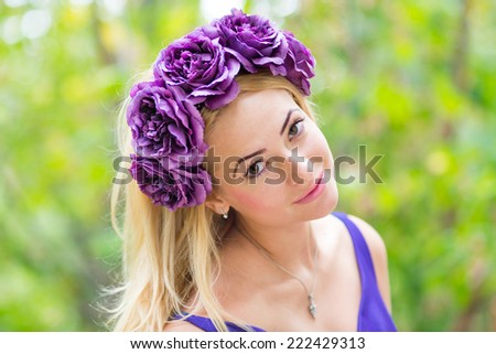 Beauty portrait of young pretty woman with flower wreath in her hair - stock photo
