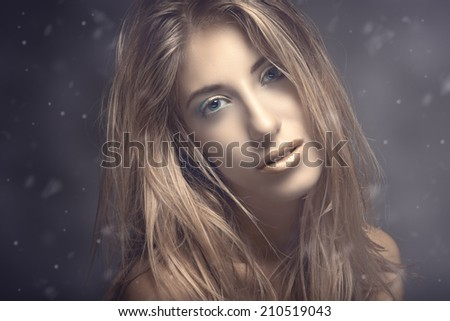 Beauty portrait of young sexy woman against blue background - stock photo