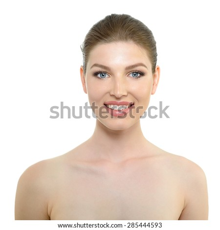 Beauty portrait of young smiling woman with beautiful healthy face, studio shot of attractive girl looking at camera over white background - stock photo