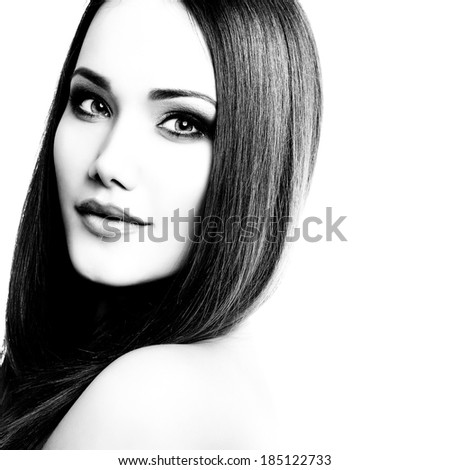 Beauty portrait of young woman with beautiful healthy face and long brown hair looking at camera, studio shot of attractive fresh girl over white background. Black and white. - stock photo
