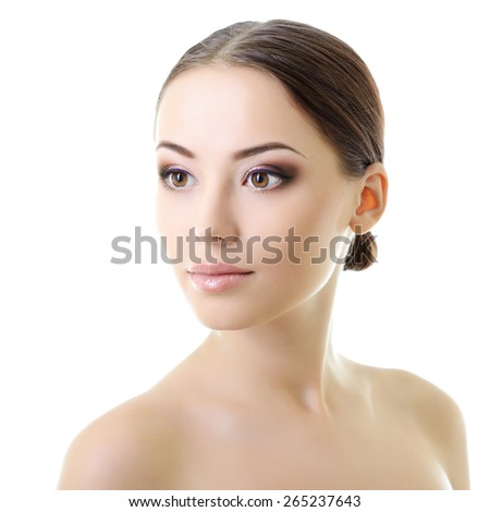 Beauty portrait of young woman with beautiful healthy face, studio shot of attractive girl over white - stock photo