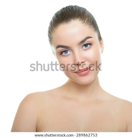 Beauty portrait of young woman with beautiful healthy face. Studio shot of attractive girl over white background. Health care, skin care, beauty treatment, cosmetology, youth and aging concept. - stock photo