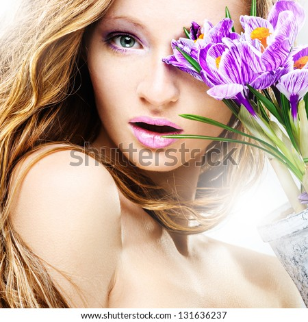 Beauty portrait young girl with purple crocus - stock photo