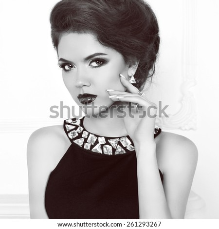 Beauty retro model woman wearing in dress with gemstones. Attractive elegant lady portrait. Makeup. Stare. - stock photo