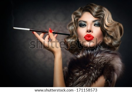Beauty Retro Woman with Mouthpiece. Vintage Styled Beautiful Lady with cigarette. Smoking Model Girl Portrait. Hairstyle and Make up  - stock photo