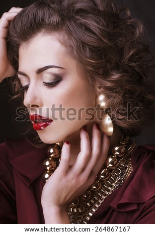 beauty rich brunette woman with a lot of jewellery, hispanic curly lady close up - stock photo