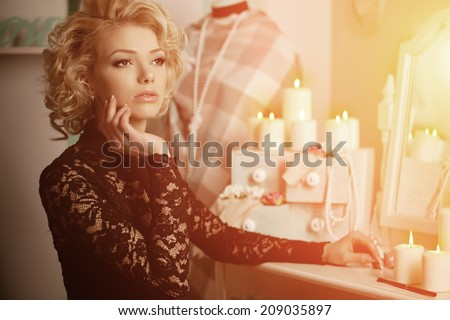 Beauty rich luxury woman like Marilyn Monroe. Beautiful fashionable girl in a retro interior - stock photo