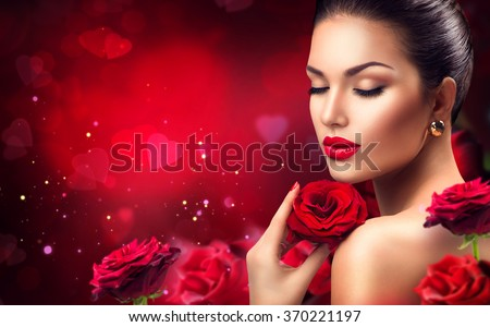 Beauty romantic woman with Red Rose flowers. Valentine. Red Lips and Nails. Beautiful Luxury Makeup and Manicure. Valentines Day border design. Portrait of fashion model girl on blurred red background - stock photo