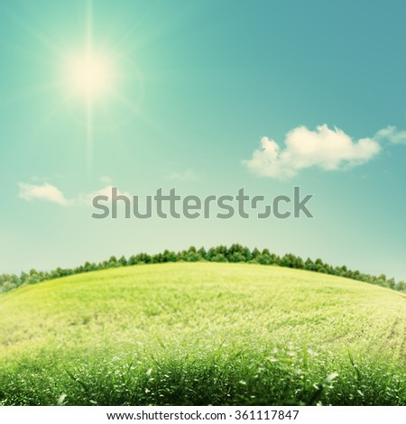 Beauty seasonal backgrounds with green hills under blue skies - stock photo