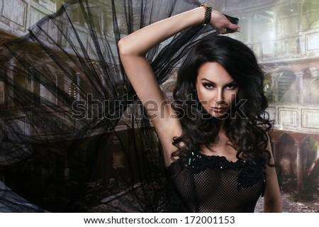 Beauty sensual woman in black dress - stock photo