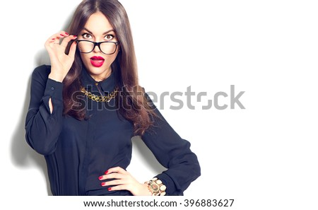 Beauty sexy fashion model girl wearing glasses, isolated on white background. Beautiful young brunette woman with trendy accessories posing in studio - stock photo
