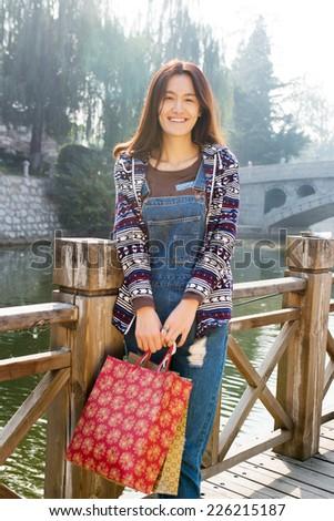 Beauty shopping Asian women with shopping bags - stock photo