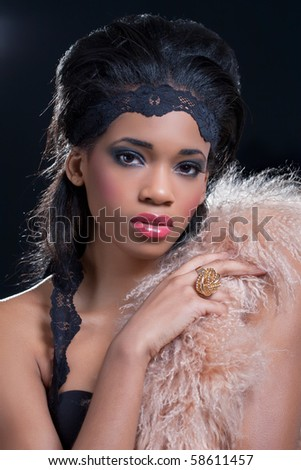 Beauty shot of a young black american woman, wearing fashionable clothes - stock photo