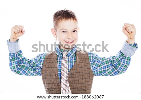 Beauty smiling sport child boy showing his hand biceps muscles strength white isolated - stock photo
